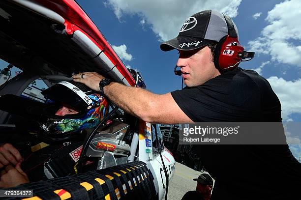 Blake Koch driver of the Celsius Healthy Energy Cola Toyota sits in his car in the garage area during practice for the NASCAR XFINITY Series Subway...