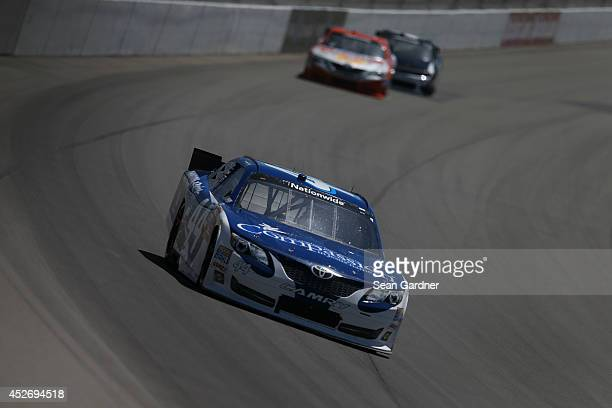 Blake Koch driver of the CompassionRacingcom Toyota drives during the NASCAR Nationwide Series Ollie's Bargain Outlet 250 at Michigan International...