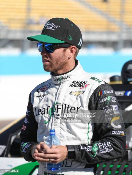 Blake Koch driver of the LeafFilter Gutter Protection Chevrolet stands by his car during qualifying for the NASCAR Xfinity series Ticket Galaxy 200...