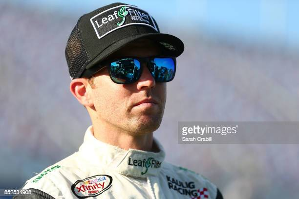 Blake Koch driver of the LeafFilter Gutter Protection Chevrolet looks on from the grid during qualifying for the NASCAR XFINITY Series...