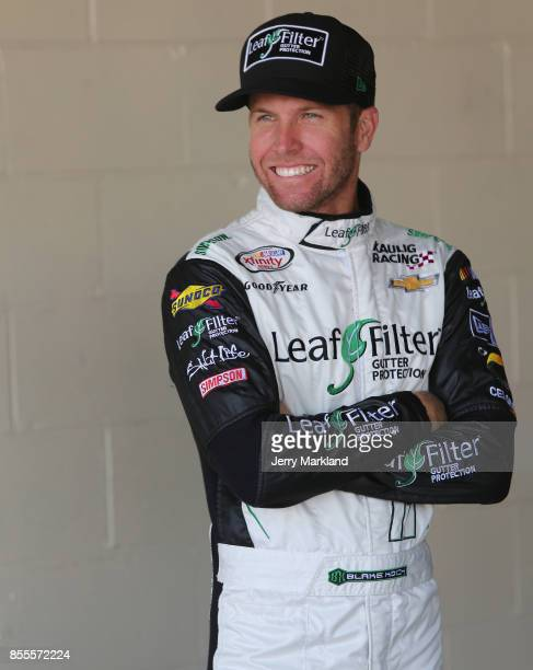 Blake Koch driver of the LeafFilter Gutter Protection Chevrolet looks on during practice for the NASCAR XFINITY Series 'Use Your Melon Drive Sober...
