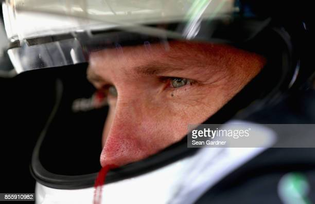 Blake Koch driver of the LeafFilter Gutter Protection Chevrolet looks on during qualifying for the NASCAR XFINITY Series 'Use Your Melon Drive Sober...