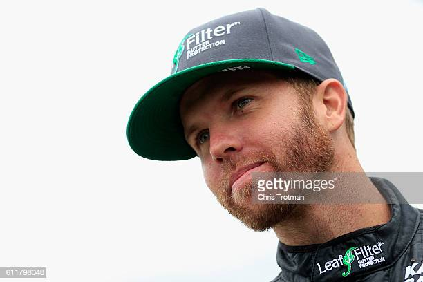 Blake Koch driver of the LeafFilter Gutter Protection Chevrolet stands on the grid during qualifying for the NASCAR XFINITY Series Drive Sober 200 at...