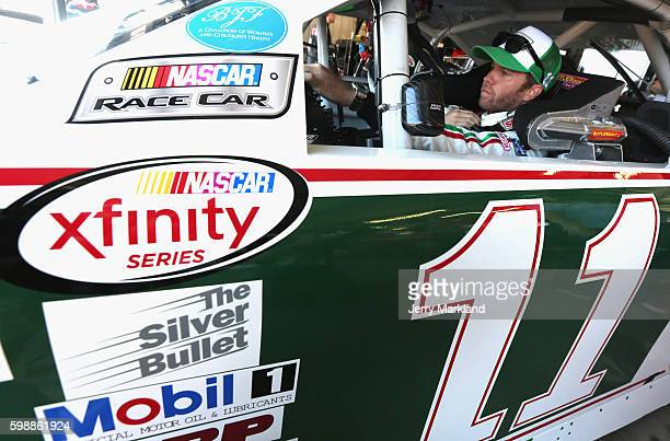 Blake Koch driver of the LeafFilter Gutter Protection Chevrolet sits in his car during practice for the NASCAR XFINITY Series VFW Sport Clips Help A...