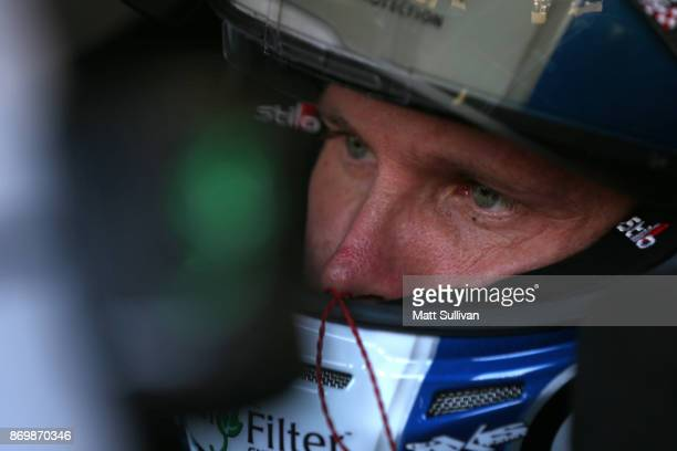 Blake Koch driver of the LeafFilter Gutter Protection Chevrolet sits in his car during practice for the NASCAR XFINITY Series O'Reilly Auto Parts 300...
