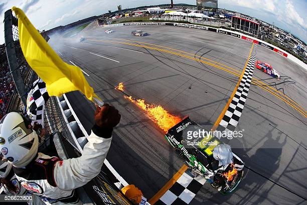 Blake Koch driver of the LeafFilter Gutter Protection Chevrolet crosses the finish line in flames after the NASCAR XFINITY Series Sparks Energy 300...