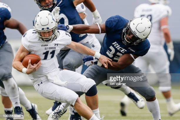 Blake LaRussa of the Old Dominion Monarchs breaks out of a tackle by Anthony Ekpe of the Rice Owls in the second half at Rice Stadium on November 24...