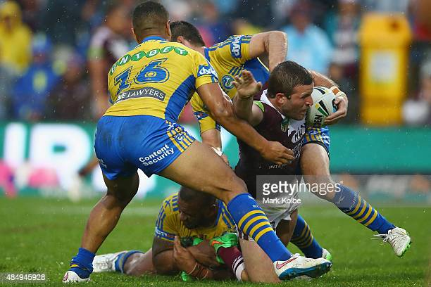 Blake Leary of the Eagles is tackled during the round 24 NRL match between the Manly Warringah Sea Eagles and the Parramatta Eels at Brookvale Oval...