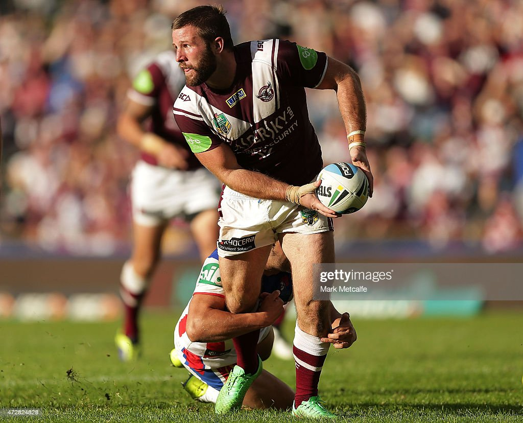 Blake Leary of the Sea Eagles offloads the ball in a tackle during the round nine NRL match between the Manly Sea Eagles and the Newcastle Knights at Brookvale Oval on May 10, 2015 in Sydney, Australia.