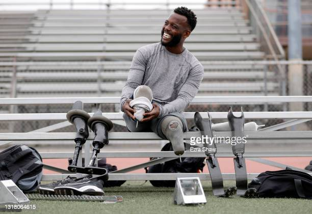 Blake Leeper switches to his racing prostheses before a training session at Dorsey High School on May 14, 2021 in Los Angeles, California. Leeper is...
