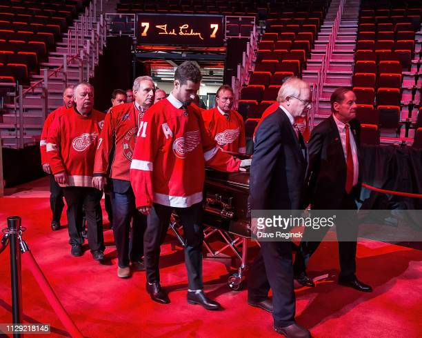 Blake Lindsay leads the Pall Bearers into the arena during the public visitation of NHL Hall of Famer and former Detroit Red Wing Ted Lindsay at...