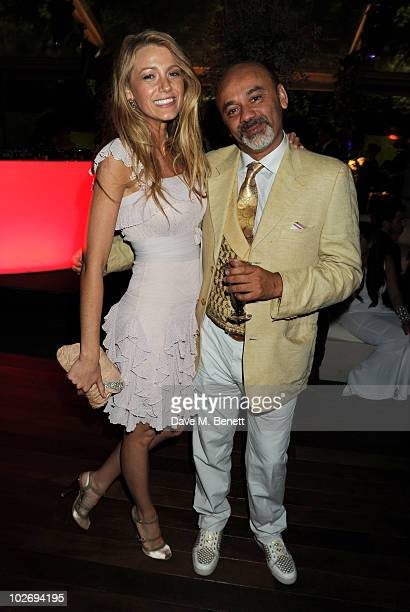 Blake Lively and Christian Louboutin attend the Valentino Garavani Archives Dinner Party on July 7 2010 in Versailles France