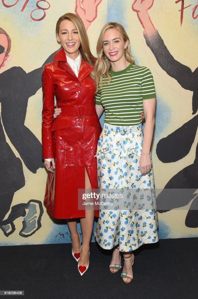 Blake Lively (L) and Emily Blunt attend the Michael Kors Collection Fall 2018 Runway Show at Vivian Beaumont Theatre at Lincoln Center on February 14, 2018 in New York City.