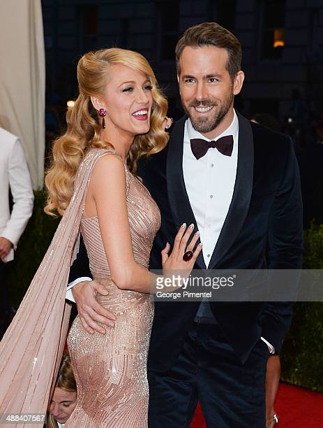 Blake Lively and Ryan Reynolds attend the 'Charles James Beyond Fashion' Costume Institute Gala at the Metropolitan Museum of Art on May 5 2014 in...
