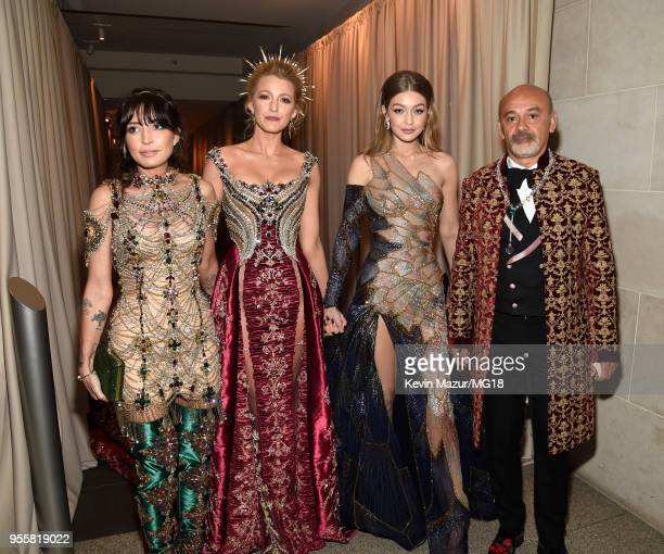 Blake Lively Gigi Hadid and Christian Louboutin attend the Heavenly Bodies Fashion The Catholic Imagination Costume Institute Gala at The...