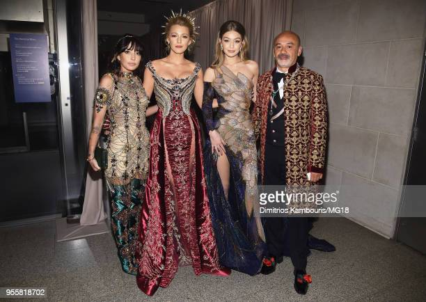 Blake Lively Gigi Hadid and designer Christian Louboutin attend the Heavenly Bodies Fashion The Catholic Imagination Costume Institute Gala at The...