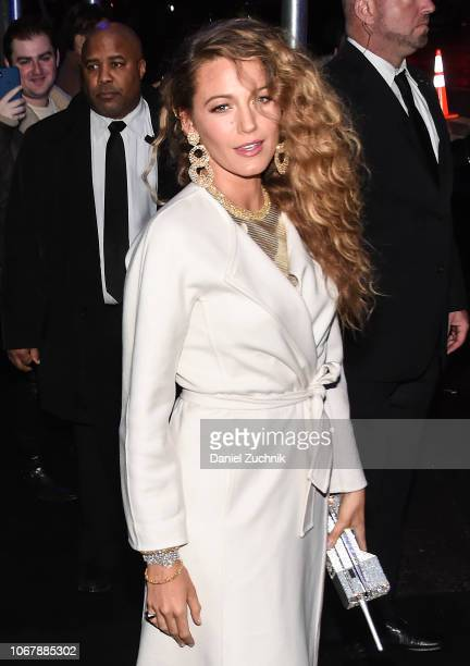 Blake Lively is seen wearing a white coat outside the Versace PreFall 2019 Collection on December 2 2018 in New York City