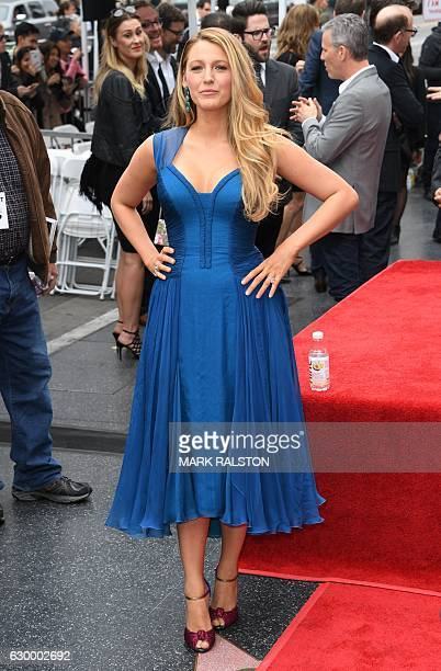 Blake Lively poses for photos at her husband actor Ryan Reynolds Hollywood star Walk of Fame ceremony in Hollywood California on December 15 2016 /...