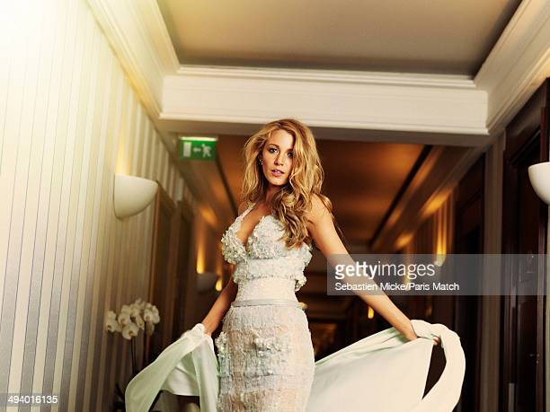Blake Lively wearing a Chanel dress poses at the Hotel Martinez during the 67th Cannes film festival on May 16 2014 in CannesFrance