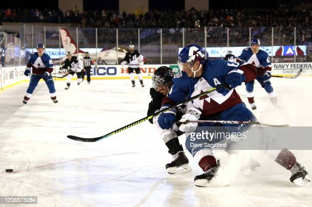Blake Lizotte of the Los Angeles Kings and Erik Johnson of the Colorado Avalanche skate for the puck during the third period of the 2020 NHL Stadium...