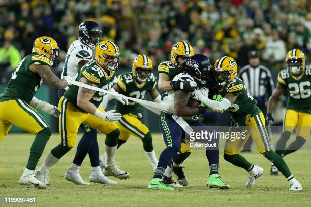 Blake Martinez Jaire Alexander of the Green Bay Packers tackle Marshawn Lynch of the Seattle Seahawks as Preston Smith of the Green Bay Packers pulls...