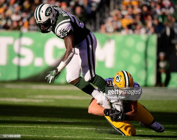 Blake Martinez of the Green Bay Packers makes a tackle on Elijah McGuire of the New York Jets at MetLife Stadium on December 23 2018 in East...