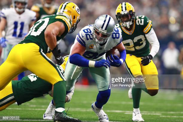 Blake Martinez of the Green Bay Packers Morgan Burnett of the Green Bay Packers and Damarious Randall of the Green Bay Packers combine to stop the...
