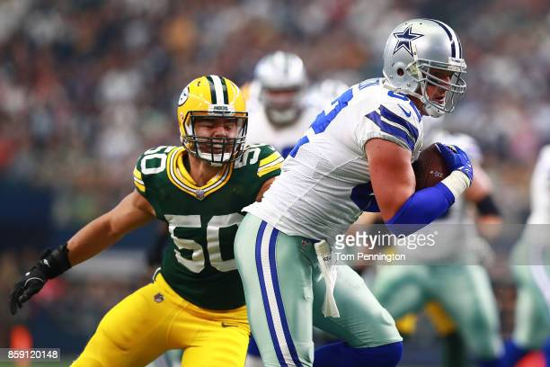 Blake Martinez of the Green Bay Packers tries to stop Jason Witten of the Dallas Cowboys in the first quarter of a football game at ATT Stadium on...