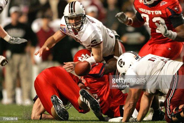 Blake Mitchell of the South Carolina Gamecocks fumbles the ball as he is tackled against the Houston Cougars during the AutoZone Liberty Bowl at the...