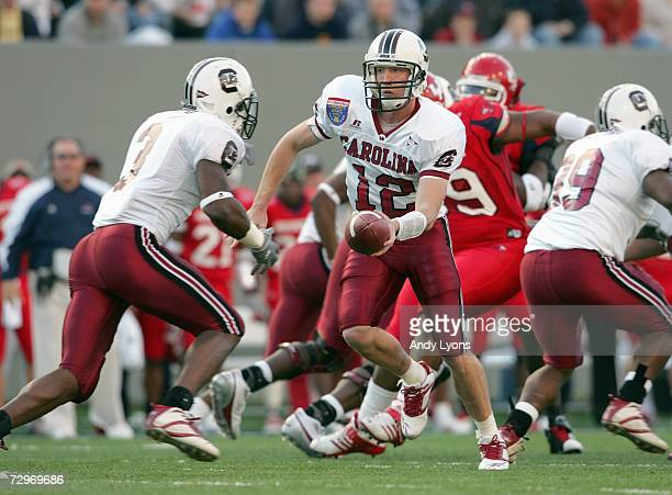 Blake Mitchell of the South Carolina Gamecocks hands the ball off to Cory Boyd during the AutoZone Liberty Bowl against the Houston Cougars at the...