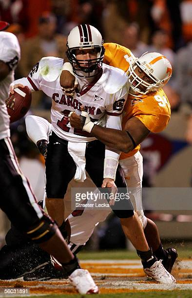 Blake Mitchell of the South Carolina Gamecocks is sacked in the end zone for a safety by Jason Hall of the Tennessee Volunteers during their game on...