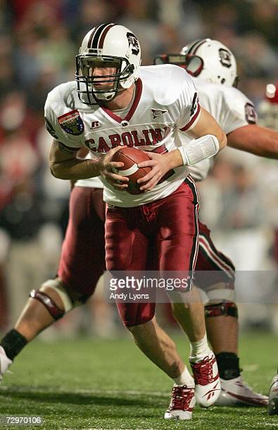 Blake Mitchell of the South Carolina Gamecocks moves back with the ball against the Houston Cougars during the AutoZone Liberty Bowl at the Liberty...