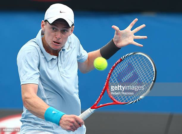 Blake Mott of Australia plays a backhand in his first round junior boys' match against Stefan Kozlov of the United States during day seven of the...