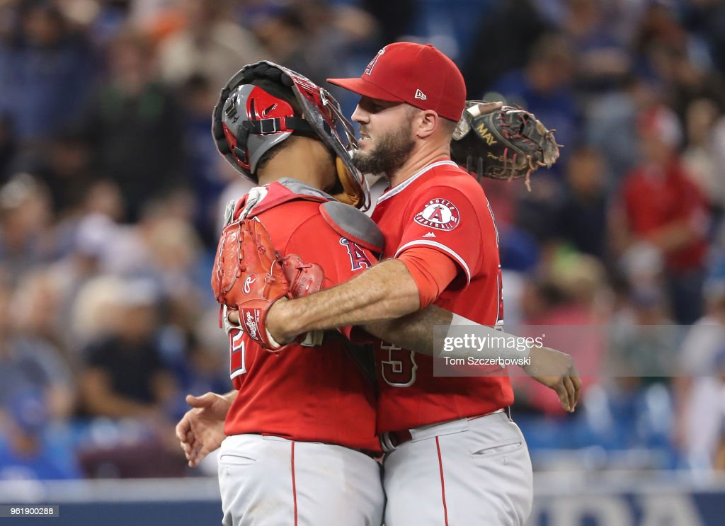 Blake Parker #53 and Martin Maldonado #12 of the Los Angeles Angels of Anaheim celebrate a victory over the Toronto Blue Jays at Rogers Centre on May 23, 2018 in Toronto, Canada.