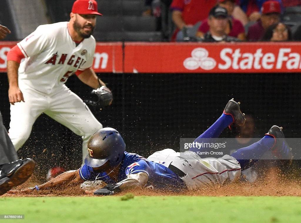 Blake Parker #53 of the Los Angeles Angels of Anaheim backs up the play as Delino DeShields #3 of the Texas Rangers scores on a sacrifice fly by Adrian Beltre #29 of the Texas Rangers in the eighth inning of the game at Angel Stadium of Anaheim on September 15, 2017 in Anaheim, California.