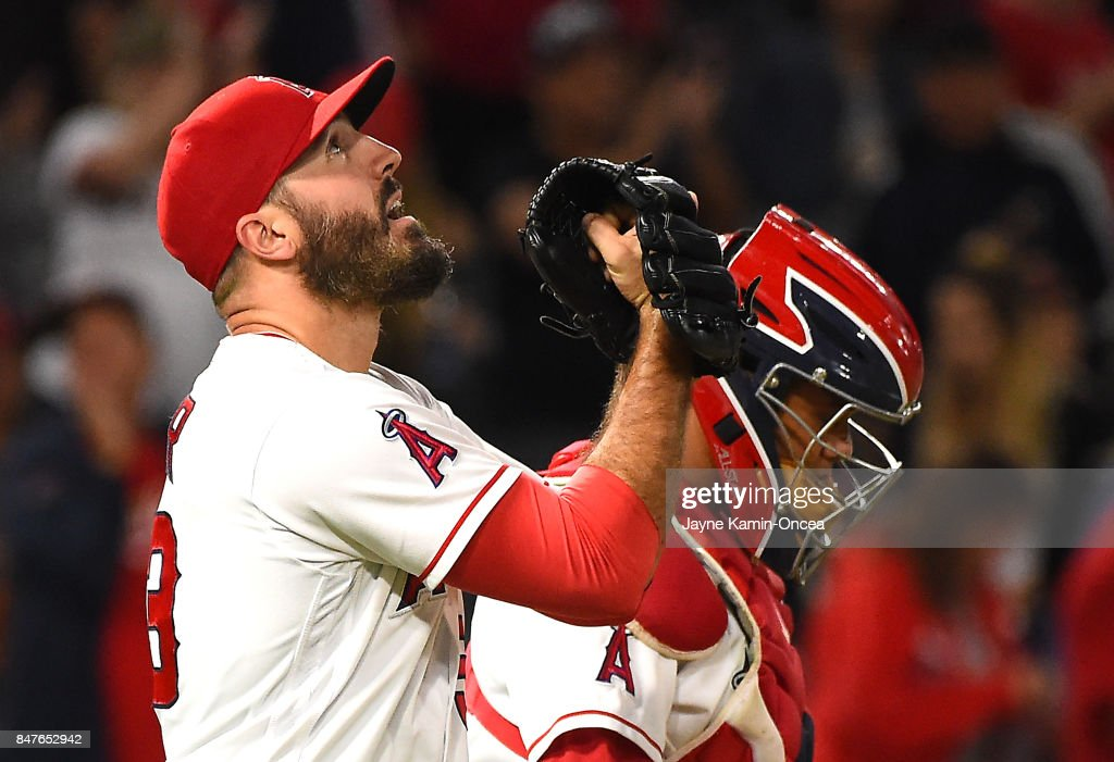 Blake Parker #53 of the Los Angeles Angels of Anaheim punches his glove after earning a save in the ninth inning of the game against the Texas Rangers at Angel Stadium of Anaheim on September 15, 2017 in Anaheim, California.