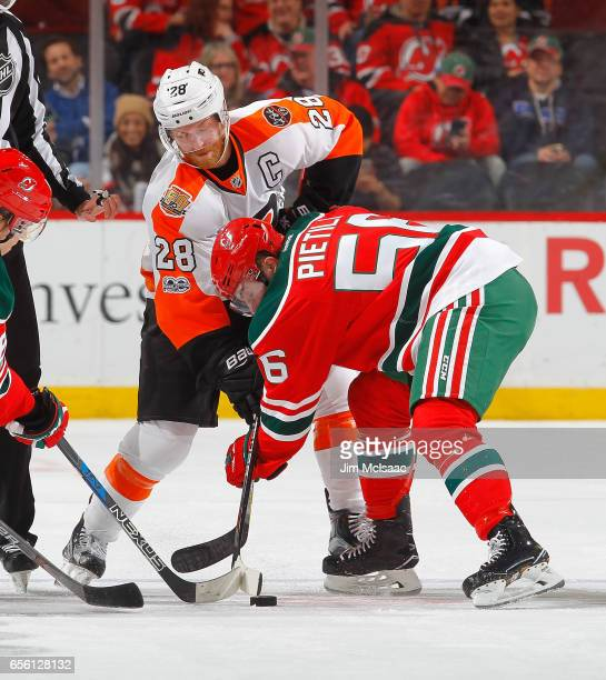 Blake Pietila of the New Jersey Devils in action against Claude Giroux of the Philadelphia Flyers on March 16 2017 at Prudential Center in Newark New...