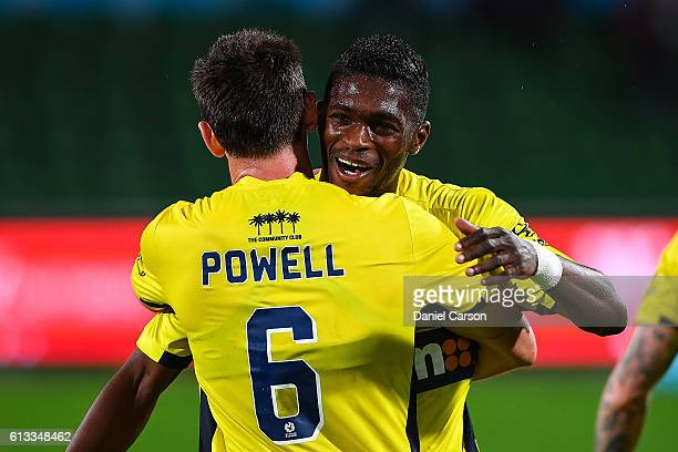 Blake Powell and Kwabena Appiah of the Central Coast Mariners embrace after the draw during the round one ALeague match between the Perth Glory and...