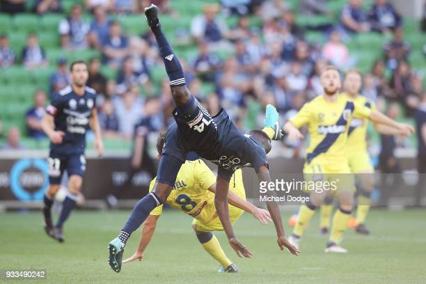 Blake Powell of Central Coast Mariners and Thomas Deng of the Victory collide in a contest for the ball during the round 23 ALeague match between the...