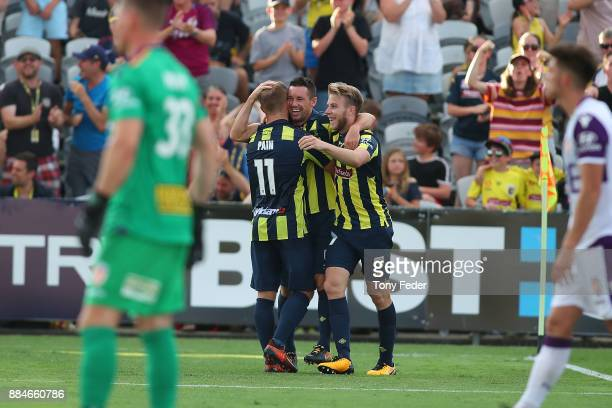 Blake Powell of the Mariners celebrates a goal with team mates during the round nine A-League match between the Central Coast Mariners and Perth...