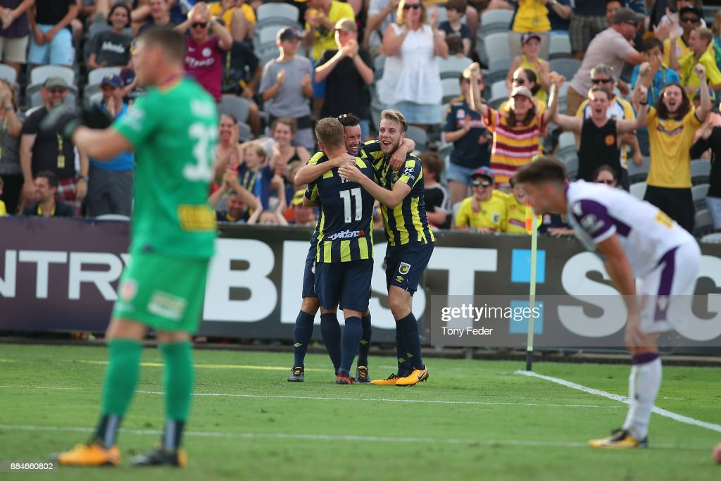Blake Powell of the Mariners celebrates a goal with team mates during the round nine A-League match between the Central Coast Mariners and Perth Glory at Central Coast Stadium on December 3, 2017 in Gosford, Australia.