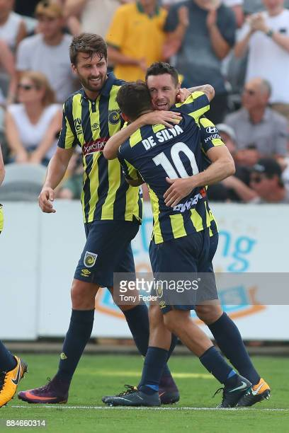 Blake Powell of the Mariners celebrates with team mate Daniel De Silva during the round nine A-League match between the Central Coast Mariners and...