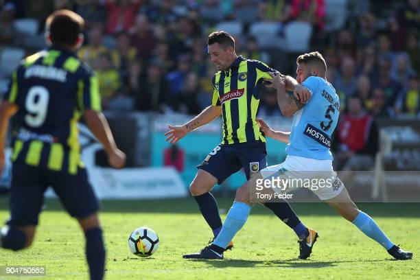 Blake Powell of the Mariners contests the ball with Bart Schenkeveld of City during the round 16 ALeague match between the Central Coast Mariners and...