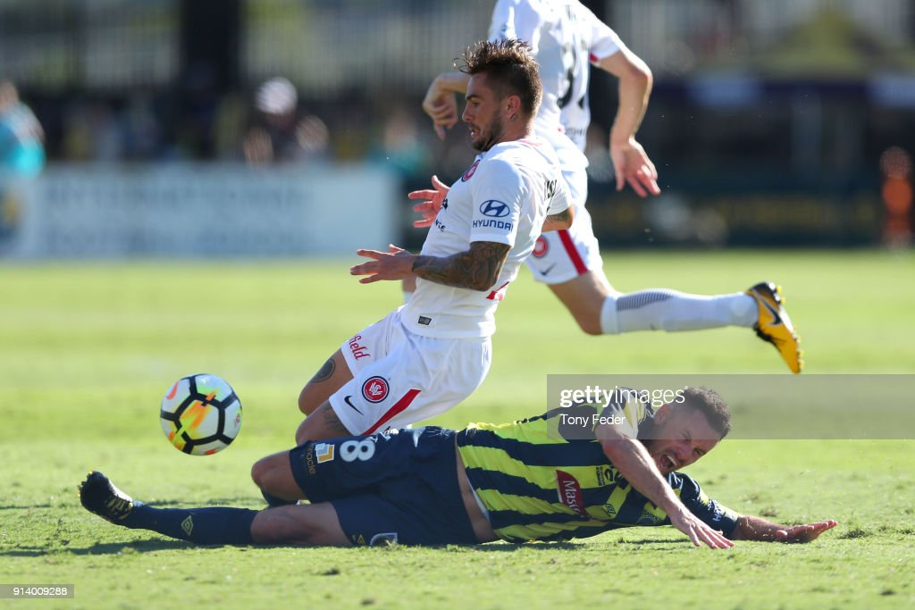 Blake Powell of the Mariners contests the ball with Brendan Hamill of the Wanderers during the round 19 A-League match between the Central Coast Mariners and the Western Sydney Wanderers at Central Coast Stadium on February 4, 2018 in Gosford, Australia.