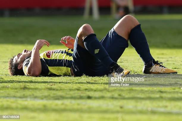 Blake Powell of the Mariners lays on the ground after the game during the round 16 ALeague match between the Central Coast Mariners and Melbourne...