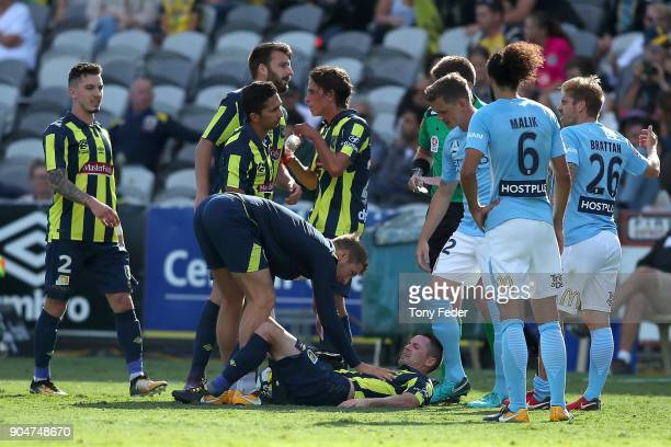 Blake Powell of the Mariners lies on the ground injured during the round 16 ALeague match between the Central Coast Mariners and Melbourne City at...