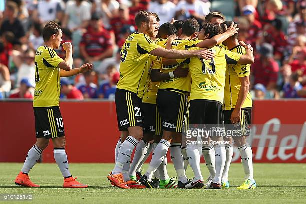 Blake Powell of the Phoenix celebrates with team mates after scoring a third goal during the round 19 ALeague match between the Western Sydney...
