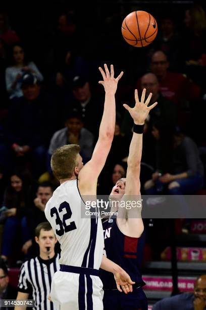 Blake Reynolds of the Yale Bulldogs floats a shot over AJ Brodeur of the Pennsylvania Quakers during the second half at The Palestra on February 3...
