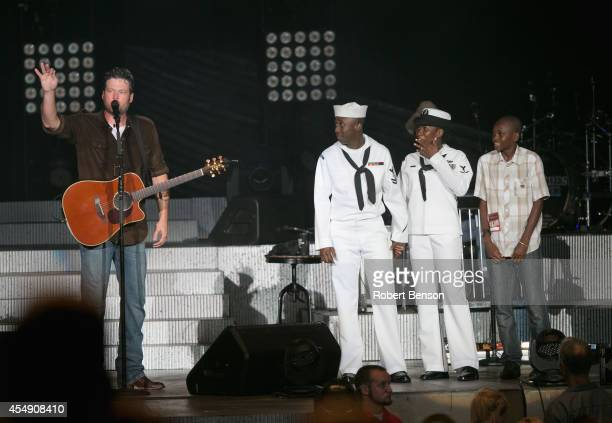 Blake Shelton and JCPenney honor a military USO family Roland Kiendrebeogo his wife Marie Esther Kiendrebeogo and their son Oswald Kiendrebeogo...