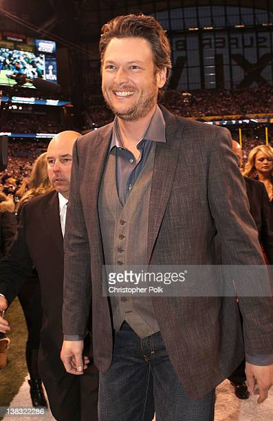 "Blake Shelton exits after performing ""America the Beautiful"" during the Bridgestone Super Bowl XLVI Pregame Show at Lucas Oil Stadium on February 5..."